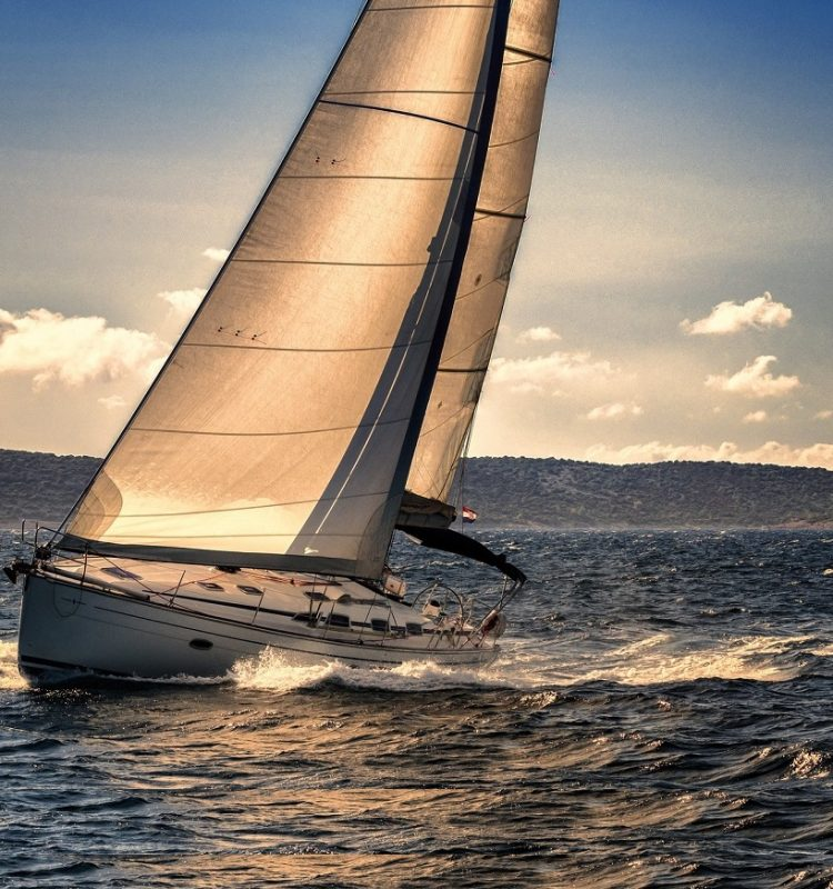 Shot of Sailing Boat Agains the Sunlight
