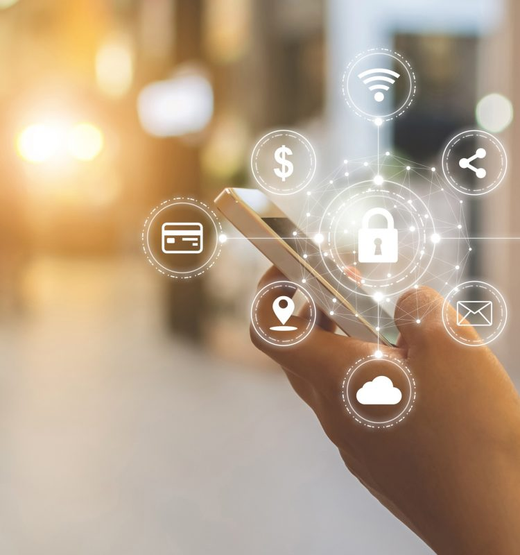 Close-up image of male hands using mobile smartphone with icon graphic cyber security network of connected devices and personal data information